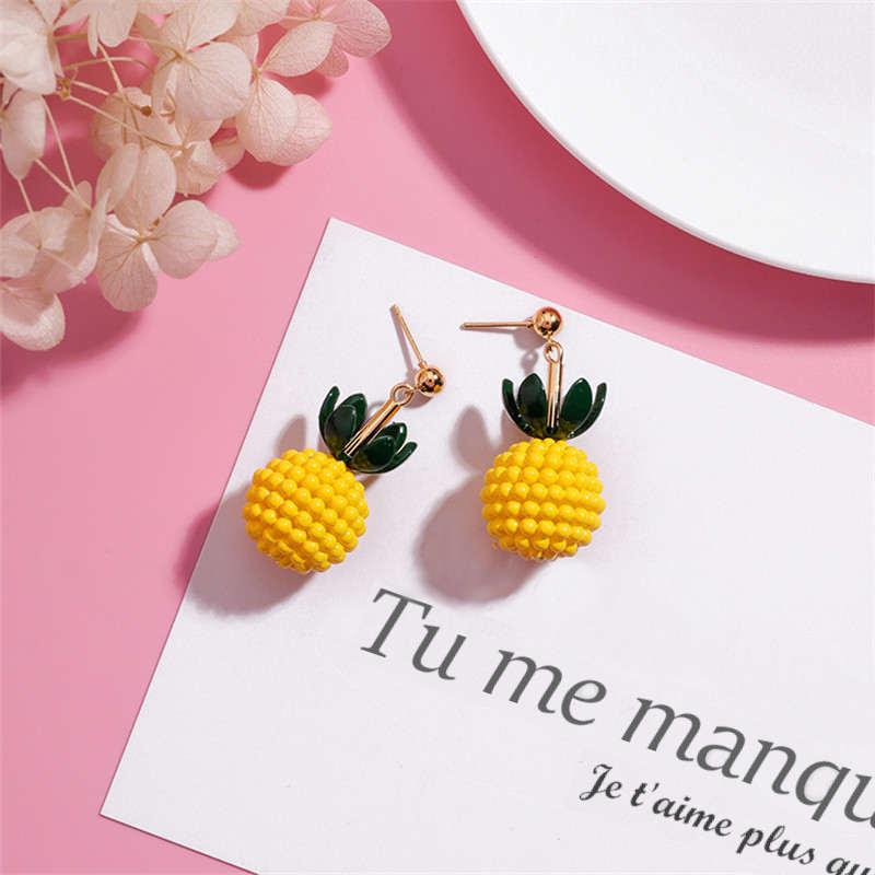 boucles d' oreilles en forme d'ananas jaune avec feuiilles vertes