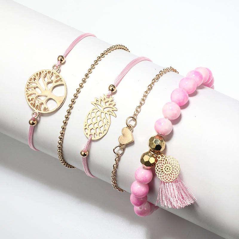 bracelet ananas rose et or avec un arbre de vie, un attrape-rêve, un coeur et un bracelet en perle
