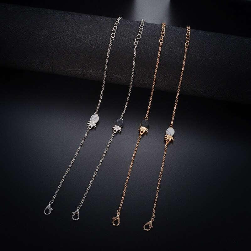 Bracelet ananas avec pierre en marbre de couleur blanche ou noire et en or ou argent sur fond noir