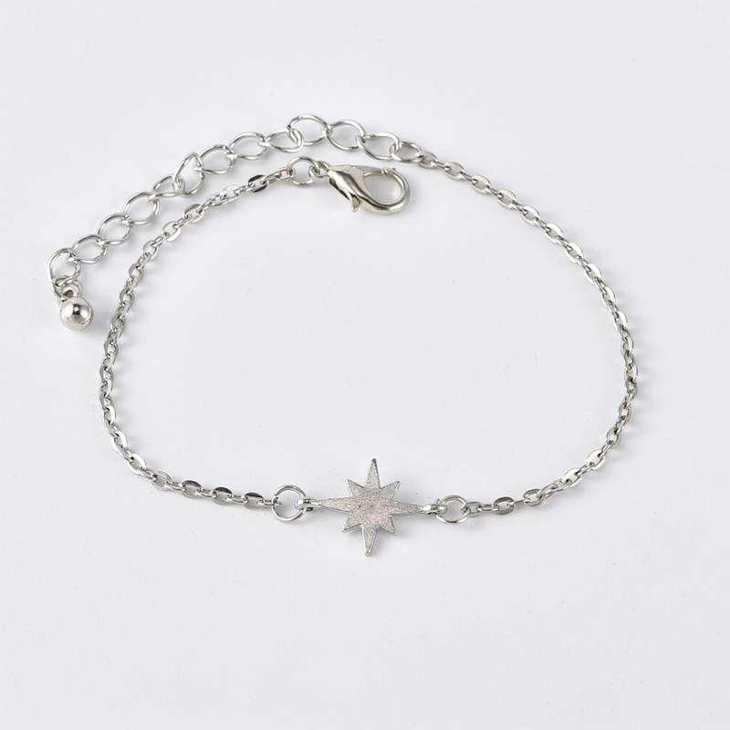 bracelet ananas plumeaux et cauris étoile