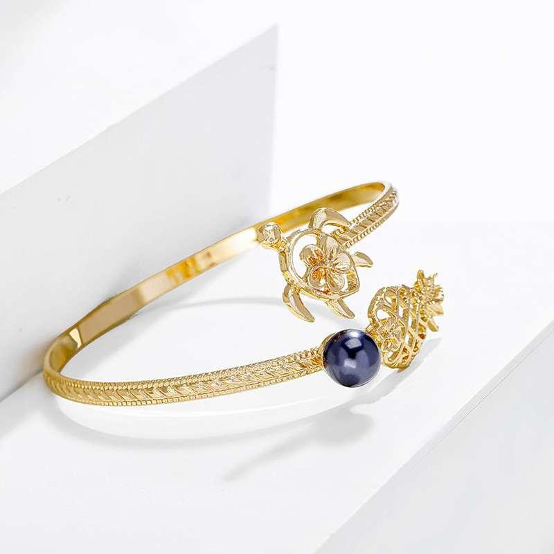 bracelet ananas et tortue doré avec perle noire de type cuff