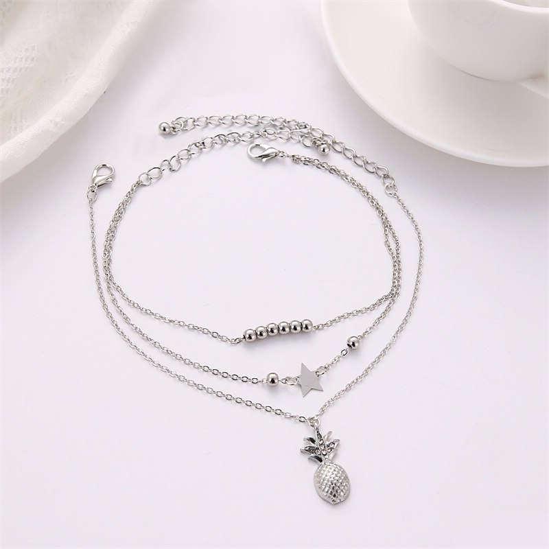 chaine de cheville ananas argent avec pendentif perles et étoiles