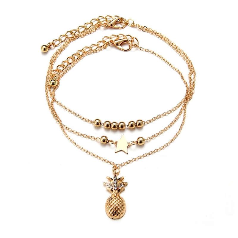 bracelet de cheville en or avec pendentif étoile et perles