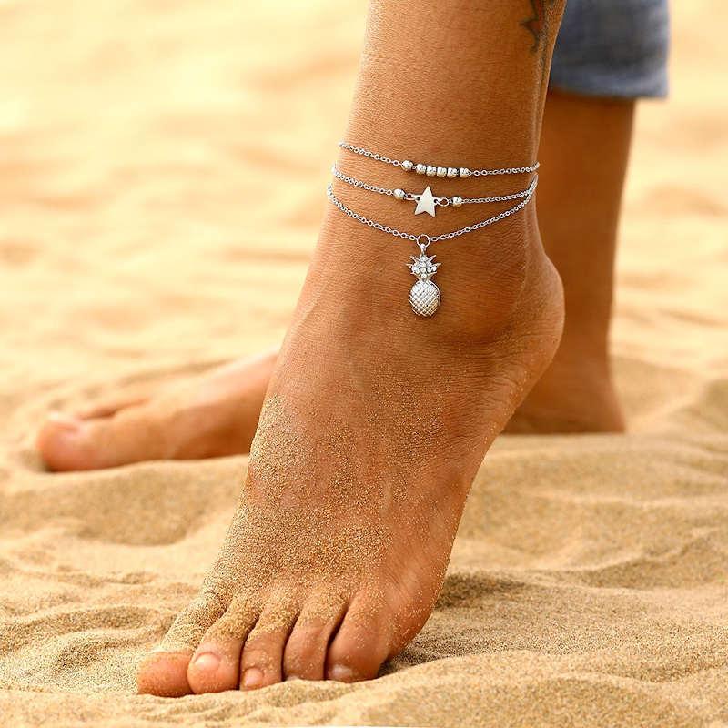chaine bracelet de cheville en argent avec pendentif ananas, étoile et perles