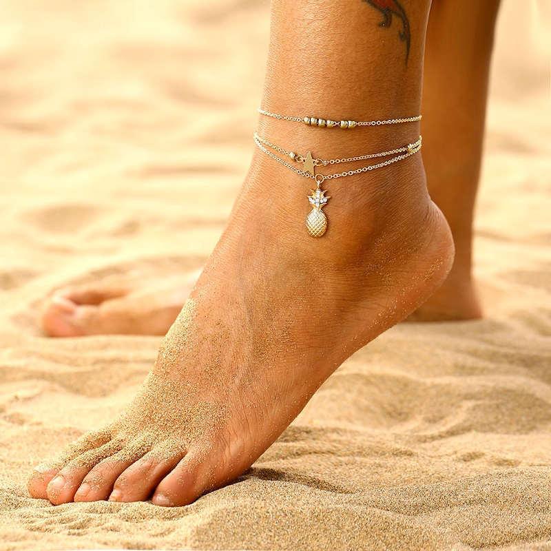 chaine de cheville ananas dorée avec pendentif étoile et perles