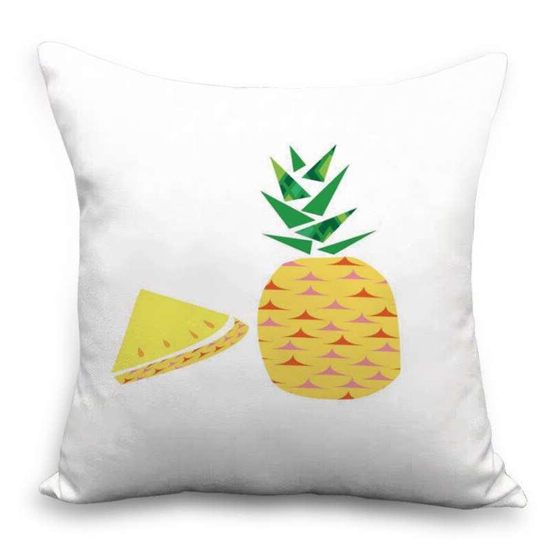 coussin imprimé d'un motif ananas et d'un quartier de fruit
