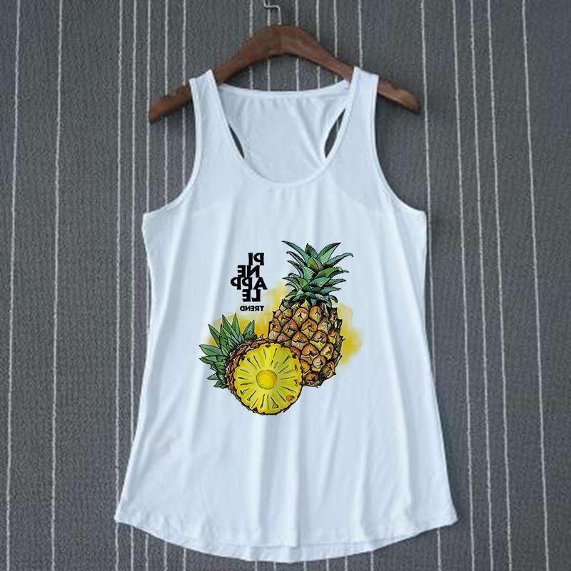 """débardeur motif ananas et texte """"pineapple trend"""" sur cintre"""