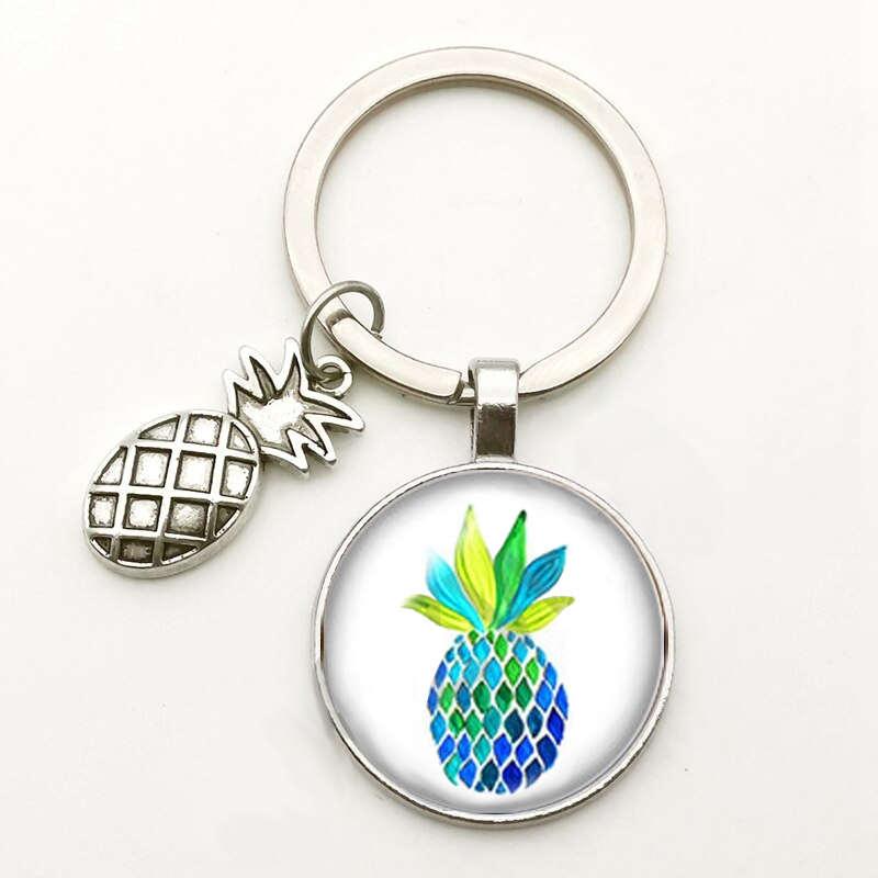 porte-clés avec motif ananas aux couleurs marines sous un cabochon