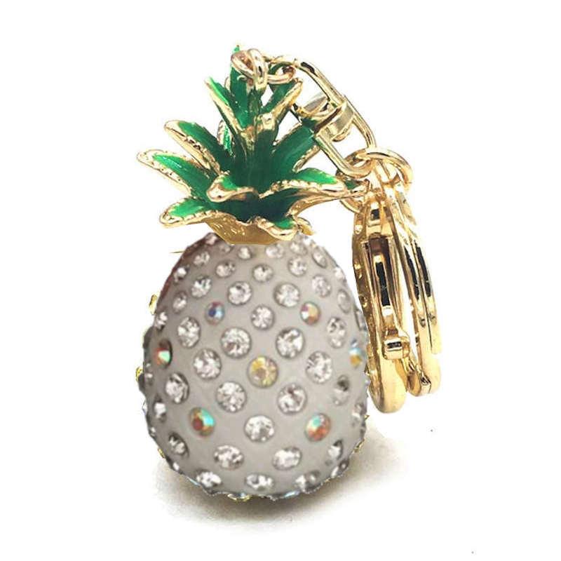porte-clef en forme d'ananas doré et blanc avec pierre de strass