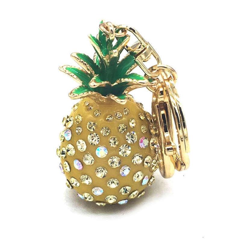 porte-clef ananas jaune et doré incrusté de pierres de strass
