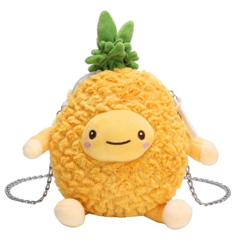 sac ananas en peluche avec visage, deux bras et deux jambes et chaine