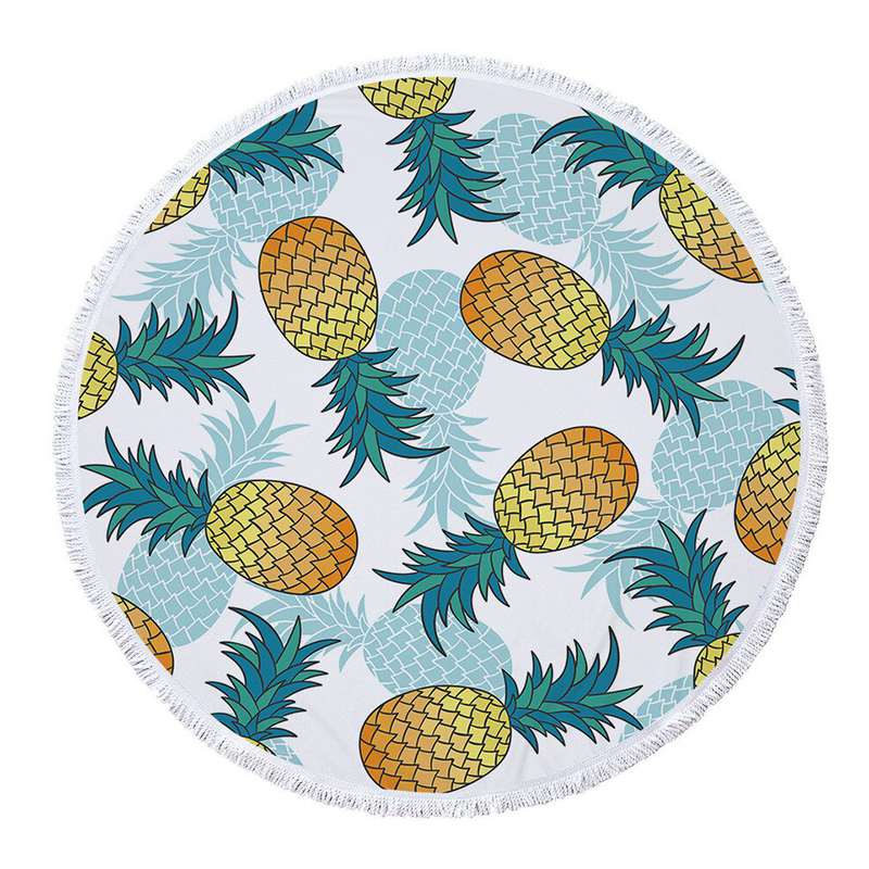 serviette de plage ronde ananas avec des ananas naturels et bleus