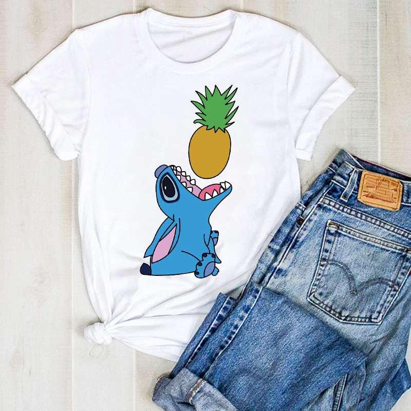 t shirt motif ananas montrant stich ouvrant sa bouche pour manger un ananas