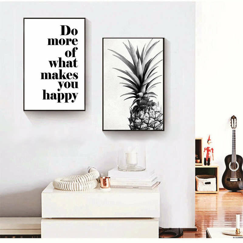 tableau ananas pour décoration maison placé au dessus d'un meuble