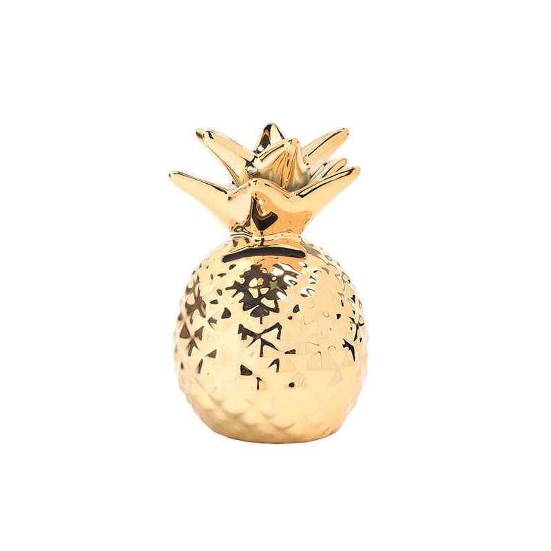 tirelire ananas en céramique dorée