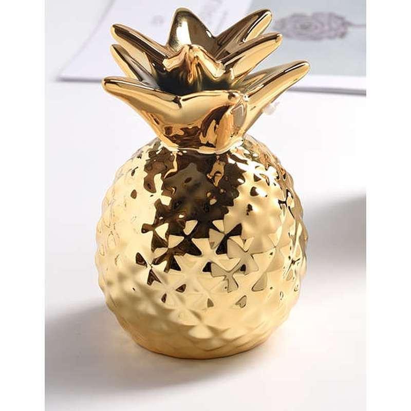 tirelire en forme d'ananas couleur dore en céramique
