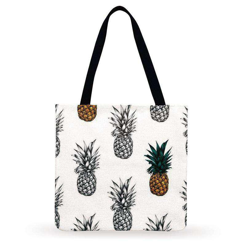 tote bag imprimés de motif ananas en noir et en couleurs